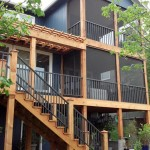Custom deck with wrought iron by Artisan Construction, 7321 N Antioch Gladstone, MO  64119