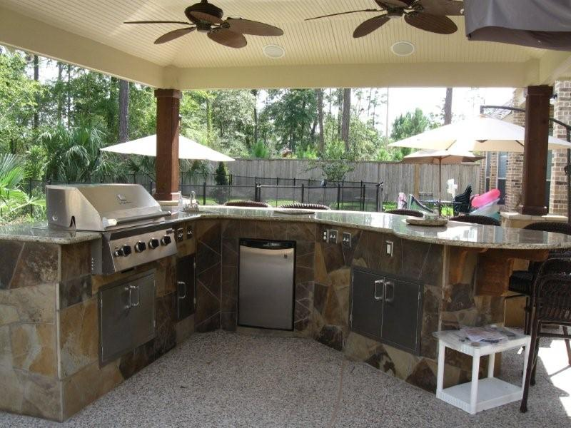 complete outdoor kitchen with granite counter tops outdoor gas grill by artisan construction 7321 - Outdoor Kitchen Designs Photos