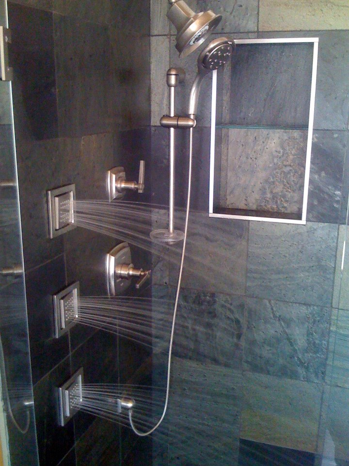 Bathroom shower with multiple heads by https://www.kcartisanconstruction.com/bathroom-remodel-kansas-city/