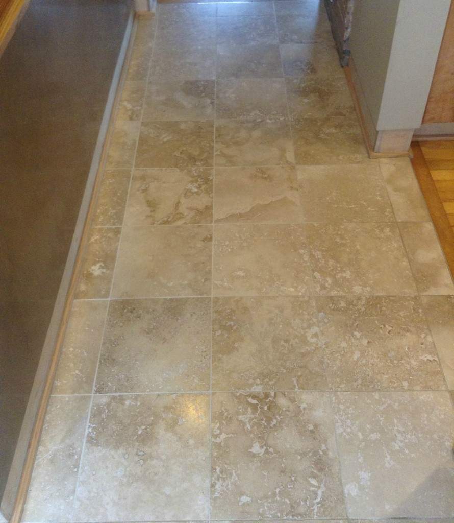 Tile flooring in hallway by Artisan Construction, 7321 N Antioch Gladstone, MO  64119